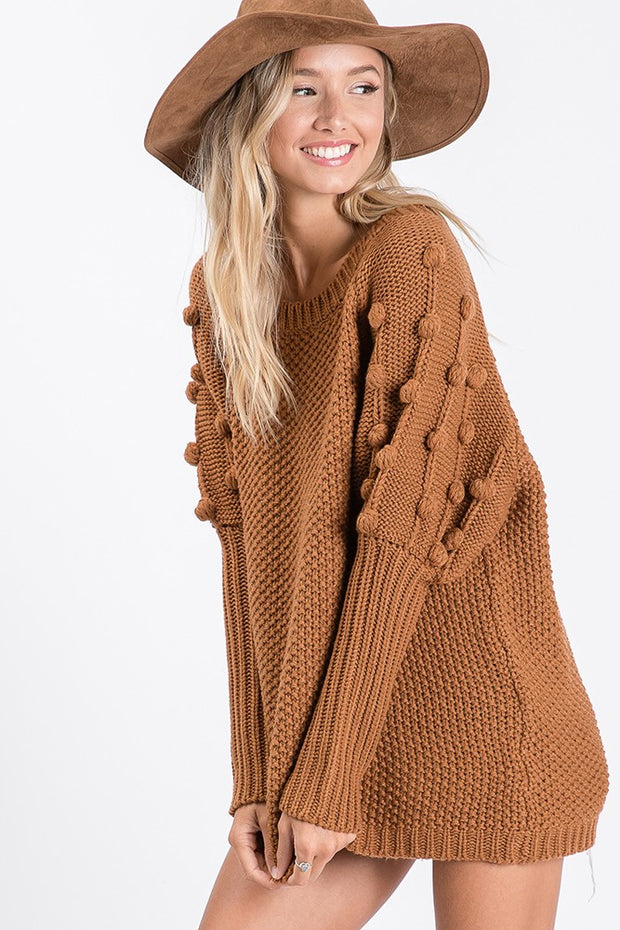 Soft textured knit, pom pom design sweater, Featuring long bubble sleeve, with ribbed cuffs, Both bodice and shoulder adorned pom pom details.