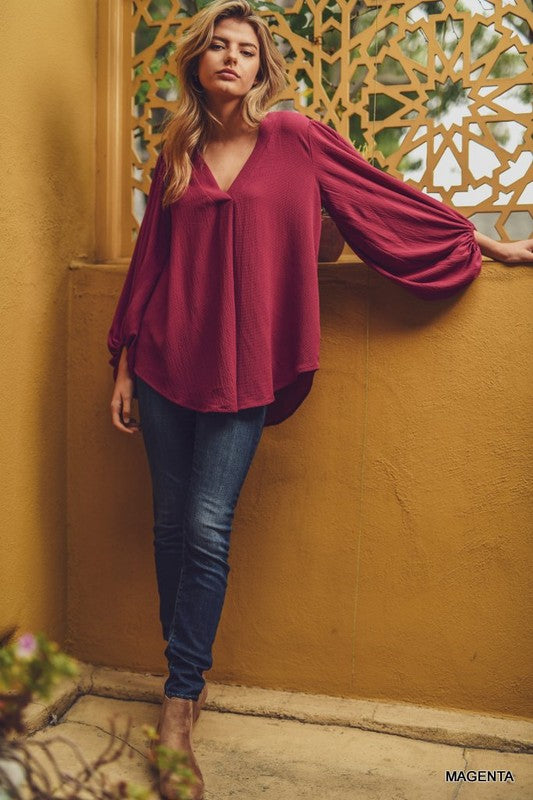 The Perfect Everyday Blouse! Great for the office, school teachers or a night out And this Magenta color is stunning!  Solid V-neck top with long draped bubble sleeves and a curved hemline. - Unlined, non-sheer, lightweight.