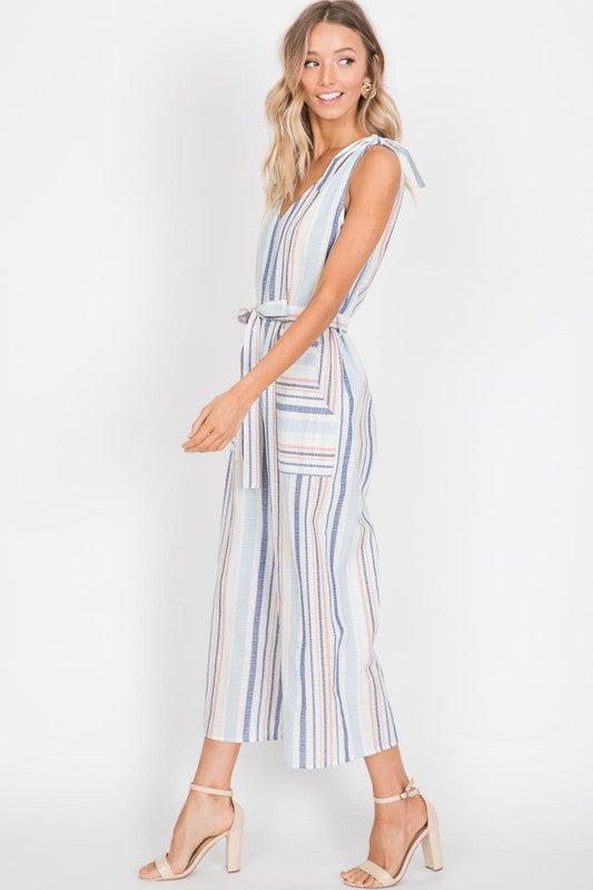 Stripes are huge this season! Pastel colored stripes on the linen blend is a woven fabric, tie details on top of the shoulders! Separate Waist Ties, Sleeveless romper with a fitted look. Made in the USA