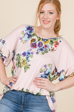 - Round neck - Short sleeves with double ruffles - Drop shoulder style - Made with buttery soft and stretchy floral polyester fabric