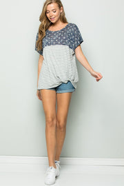 A slub knit top featuring a knotted front , round neckline, with star print shoulder and striped print.  65% rayon 35% poly