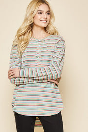 Oversized knit tunic top with button detail on front. Easy fit comfortable chic stretchy and non-sheer.