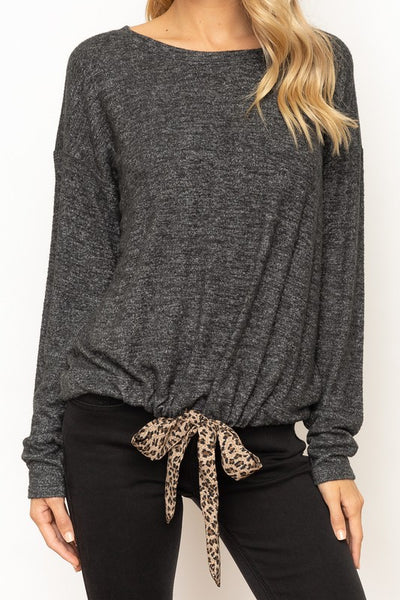 boho pretty boutique leopard tie detail top Don't Want to Fully Commit to the Leopard Trend? Then this top is for you !   Just a little leopard tie detail at the bottom with a charcoal color top.   Tie At Bottom Round Neck Top.   75% Polyester 21% Cotton
