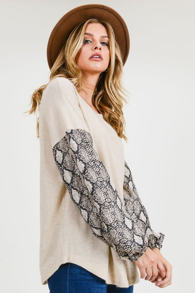 Snake Contrast Top With A Round Neckline, featuring Snake Print 3/4 Balloon Sleeves, Elasticized Wrist And Curved Hem.