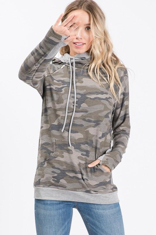Stay warm and stylish in this camo sweatshirt with double hoodie! It features two drawstrings, a  side zipper, and thumb holes!  82% Polyester 15% Rayon 3% Spandex