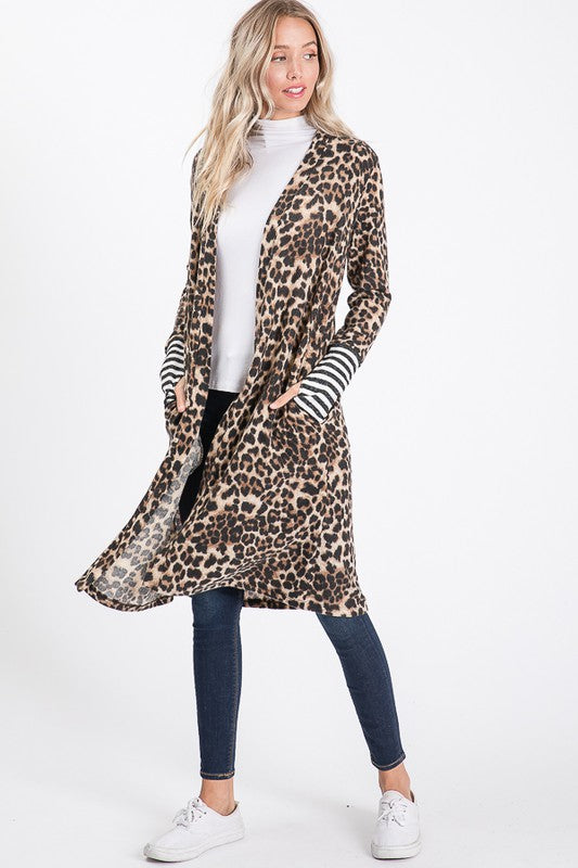 Super Comfortable! And a Staple Piece for anyone loving the Animal Print This year!  Animal Print Cardigan with Stripes on Wrist.  96%POLY 4%SPANDEX