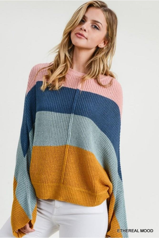 Soft sweater with color block stripes and hints of fall. This comfy chic sweater will have you feeling all the pumpkin and spice vibes.
