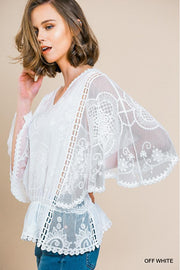 Bell Sleeve Tonal Floral Lace V-Neck Top With Elastic Ruffle Hem and Crochet Details.