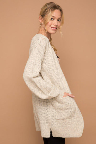 Great Staple Cardigan for Everyday Wear!  Jacquard knit sweater cardigan with volume sleeve.  True To Size.