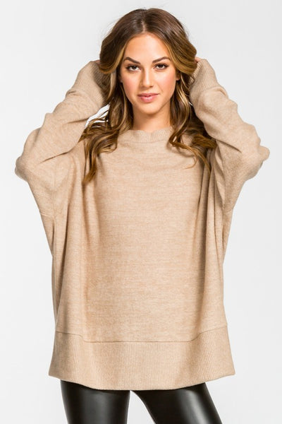 Great Everyday Top in Neutral Charcoal and Taupe Colors.  Extremely Comfortable.  Brushed Knit Long Sleeve . Loose Fit Round Neck. Pullover Top Relax Fit Round Neck Long Sleeves Brushed Knit Tunic Top.  79% Polyester 14% Rayon 7%Spandex Cont. 83% Polyester 14% Rayon 3% Spandex