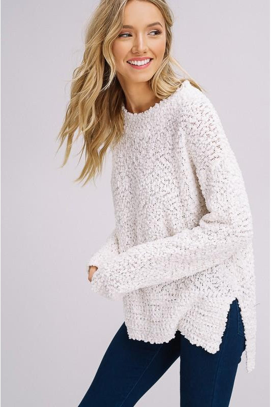 "- Popcorn texture pullover sweater - Soft popcorn texture yarn - Side slits - High and low hem - Round neck - Ribbed on neck, cuff and hem - Model is 5' 9"" 33-24-34 and wearing a size Small"