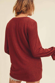 CASHMERE BRUSHED TOP WITH A ROUND NECKLINE, LONG SLEEVES WITH ELASTICIZED LEOPARD RUFFLE DETAILS