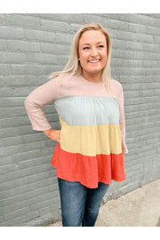 How Fun Is This Top! Great For All Year Round and The Tiered Look Gives It That Cute Detail.   Color Block Tiered Scoop Neck Top Featuring Double Button Closure Detail At Back. Non Sheer. Woven. Lightweight. 80% Polyester 20% Rayon
