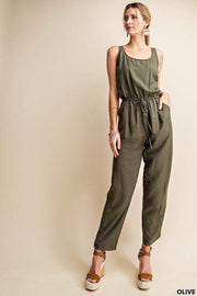 If You've Never Tried A Jumpsuit, Now Is Your Chance!  This Brand Runs So Nice!   Olive is Such A Great Versatile Color  You Can Pair This With a Light Cardigan or Jean Jacket!  Waist String Jumpsuit