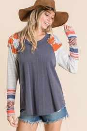 Solid ribbed knit fabric mixed matched top, Features long sleeves, boat neckline, floral and multi print knit contrast sleeve detail.  navy boho pretty boutique