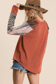 Solid ribbed knit self fabric mixed matched top, Features long sleeves, boat neckline, sequins contrast shoulder, animal and multi print contrast detail sleeves .