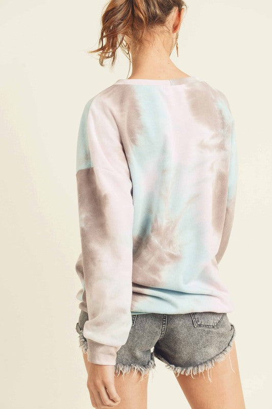 TIE-DYE COTTON TOP WITH A ROUND NECKLINE, DROPPED SHOULDERS, LONG SLEEVES, AND BANDED HEM boho pretty boutique