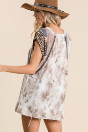 Tie dye print and contrast fabric mix and match top, features short sleeve, round neck, side slits, tunic length, animal and multi print knit fabric contrast shoulder, armhole trim detail.