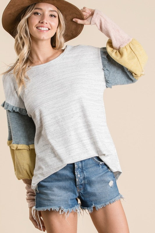 Two tone fabric knit fabric boxy top with sleeves contrast color block ruffle detail. boho pretty boutique