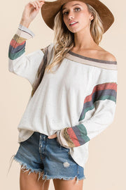 Two tone knit fabric mix and match casual top,  Features dolman long sleeves, boat neckline, multi color stripe contrast detail neck and cuff with armhole, raw edge neck and cuff detail, round hem. boho pretty boutique