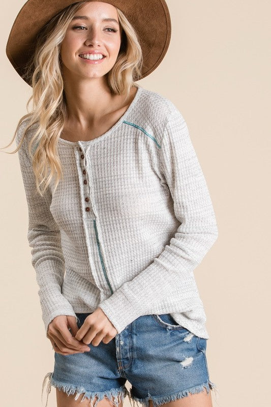Waffle knit fabric casual top, Features long sleeve, button closure front neck, reverse stitch and raw edge front, round hem.  boho pretty boutique