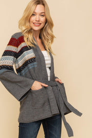 Perfect for cuddling up next to the fire with a cup of hot cocoa !   Bell Sleeve Aztec Stripes With Belted Long Cardigan with Pockets.   60% Acrylic 40% Cotton.