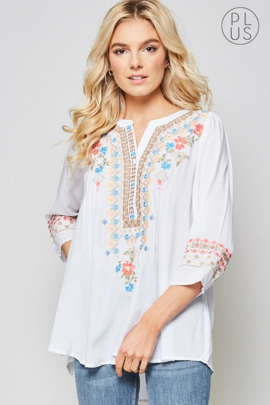"This tunic has a boho chic vibe! Button down on front with 3/4"" sleeves. Flowy bodice with round hemline"