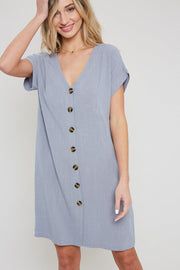 A woven mini dress with v-neckline and button down   70%VISCOSE / 30%LINEN
