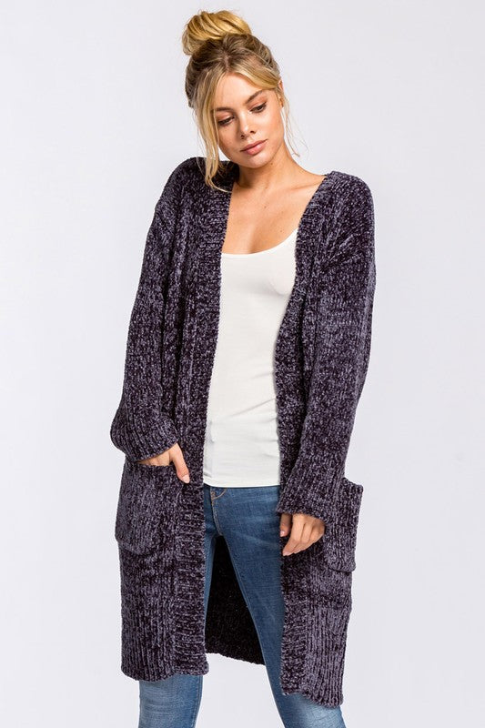 Loose fit, long sleeve, open closure cardigan. Ribbed detailing at neck, sleeve band and waistband. Pockets at sides. approximately knee length. This cardigan is made with heavyweight chenille knit fabric