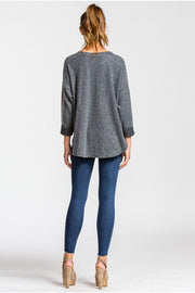 Loose fit, round neck, three-quarter length sleeve top. Sleeves are cuffed and tacked. This top is made with heavyweight, brushed french terry knit fabric that has a very soft fuzzy texture, drapes well and is very warm. This fabric has good stretch.