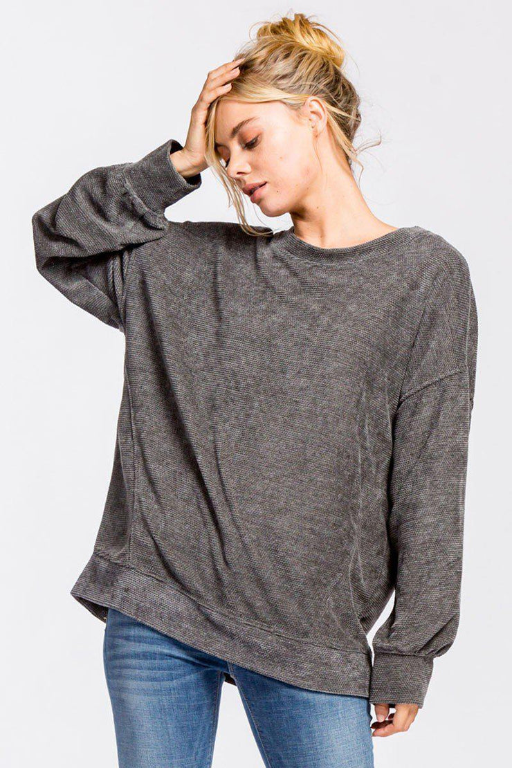 Loose fit, round neck, long sleeve top. This top is made with a heavyweight chenille fabric that is very soft, drapes beautifully and stretches very well.