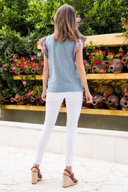 Denim Blue Embroidered V-Neck Top With Flutter Sleeves.  Pair With White Shorts or Our Sierra Pant!  100% Cotton thml boho pretty boutique