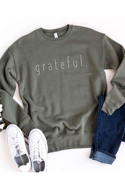 """grateful."" design in vintage white on a soft pine color sweater.  FIT: Unisex and runs true to size"