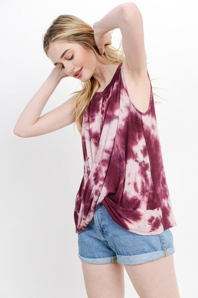 Loose fit, round neck, sleeveless hi-low tank top. Rounded back hem. Overlapping twist at the front. Has cut out detail at back. Has center front and back seam. It is made with medium weight, tie dyed knit jersey that is soft, drapes and stretches well.