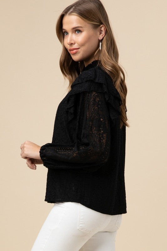 This Top is Great for Date Night or A Holiday Party!  Lace Mock Neck Top Featuring Tiered Ruffle Detail At Shoulder. Elasticized Sleeve. Keyhole Button Closure At Back. Lined and Semi Sheer   70% Cotton 30% Nylon.