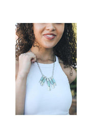 This turquoise necklace showcases five pendants on the chain and a lobster clasp closure.  50% Turquoise 50% Zinc Alloy