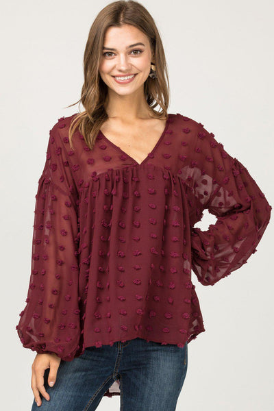otted-swiss v-neck babydoll top featuring elasticized cuff detail. Asymmetrical hem. Partially-lined. Semi-sheer. Woven. Lightweight. 100%POLYESTER Boho Pretty Boutique