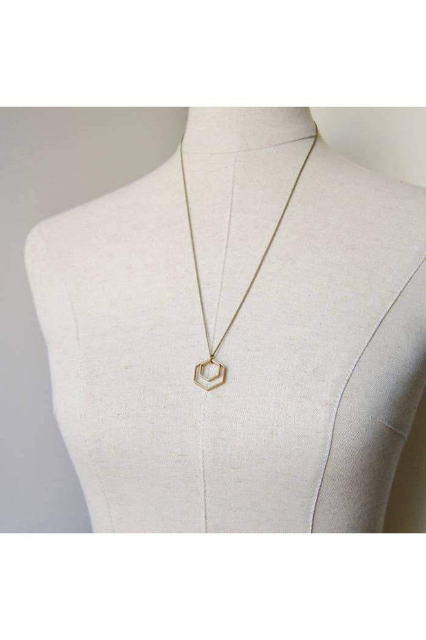 "Necklace length: 24 Inches; Pendant height: 7/8 Inches; Pendant width: 7/8 Inches  Two brass hexagons paired together (7/8"" tall), swinging from a simple brass chain (nickel free). It is a sleek & lightweight necklace for the lover of simplicity, shapes, and minimal design. I love the symmetry and balance between the two charms, and how they look stronger together."