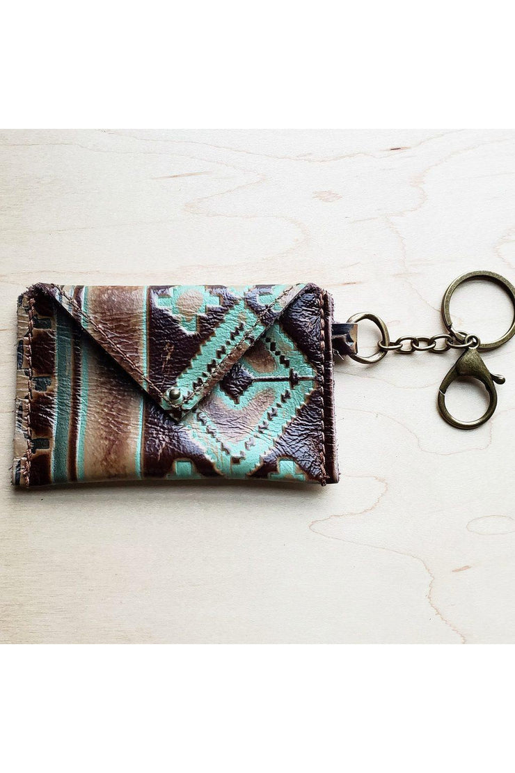 "Genuine Leather Handmade 4""x3""  Embossed Hide Handmade Genuine Leather Wallet is sourced and made in Texas. Comes with an attached clip and key ring"