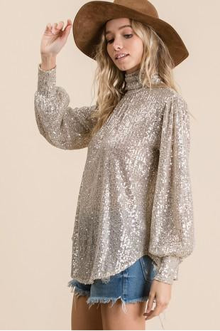 Sequins fabric turtle neck dressy top, Features long sleeve, billow long sleeve, banded cuff, turtle neck, pleating front detail, round hemline, button closure and keyhole back.