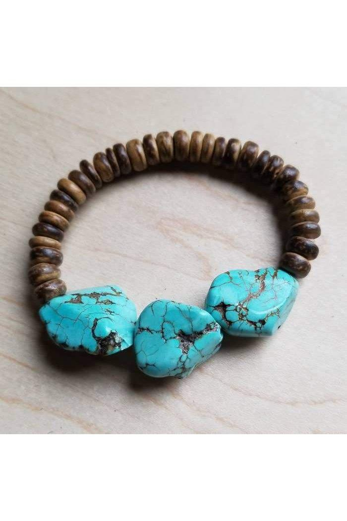 Single Strand Wood Bracelet mixed with Chunky Turquoise Beads come together to create a one-of-a-kind bracelet. Pairs great with the matching necklace. Wood Bead Size: 8mm Turquoise: 12-16 mm Beads  Although your bracelet will resemble the photo, each piece is created by hand, so no two are identical.