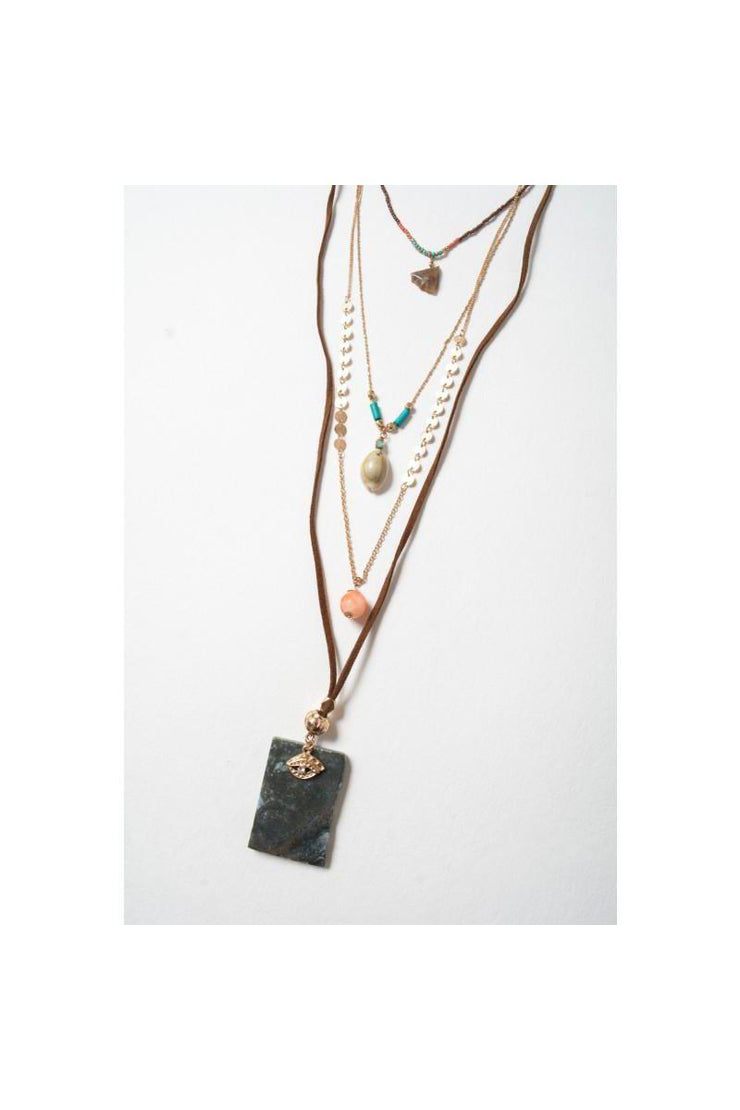 "Achieve a Bohemian look with this 4 Layer Stone & Shell Pendant Necklace.  Adjustable Chain Clasp  40% Faux Suede  30% Brass  25% Acrylic Bead  4% Stone 1% Shell Size 18"" Round Length Drop Neck Length 18""    Made In India."