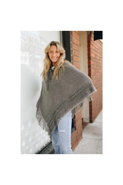 "Shop this Closet Staple for your Fall and Winter Collection,  Classic Knit Hooded Poncho. 100% Acrylic  Dimensions 16"" Shoulder to Shoulder 39"" Drop Neck to Bottom 39"" Width"