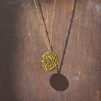aria, gold coin necklace