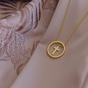 Cute Gold Plated Cross Necklace on fabric