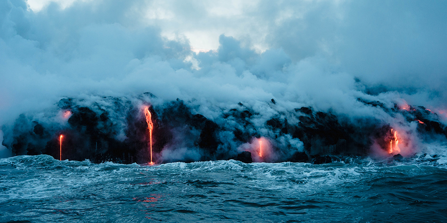 lava dripping off an edge into the ocean