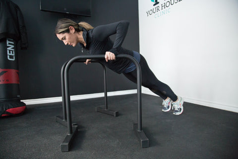 Woman doing a push-up on rails