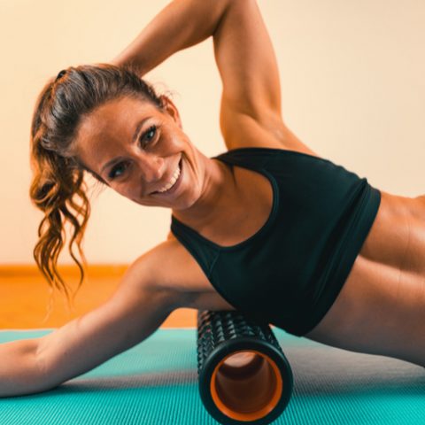 Woman stretching out on a foam roller