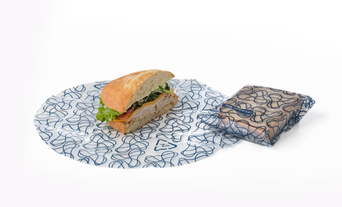 Wrap sandwiches, cheese, fruit, and more with this handy reusable pack of two U-Konserve Food Kozy Wrap!