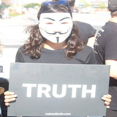 woman participating in anonymous for voiceless protest
